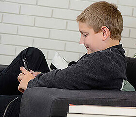 young boy looking at mobile phone