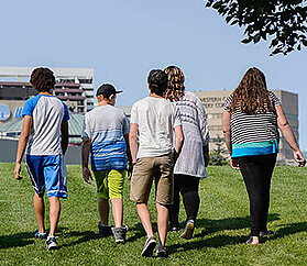 teens walking on the grass