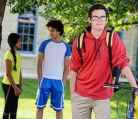 teen holding bike