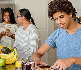 three teens making lunch
