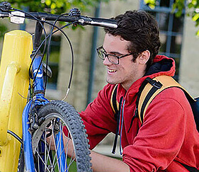 teen fixing bike